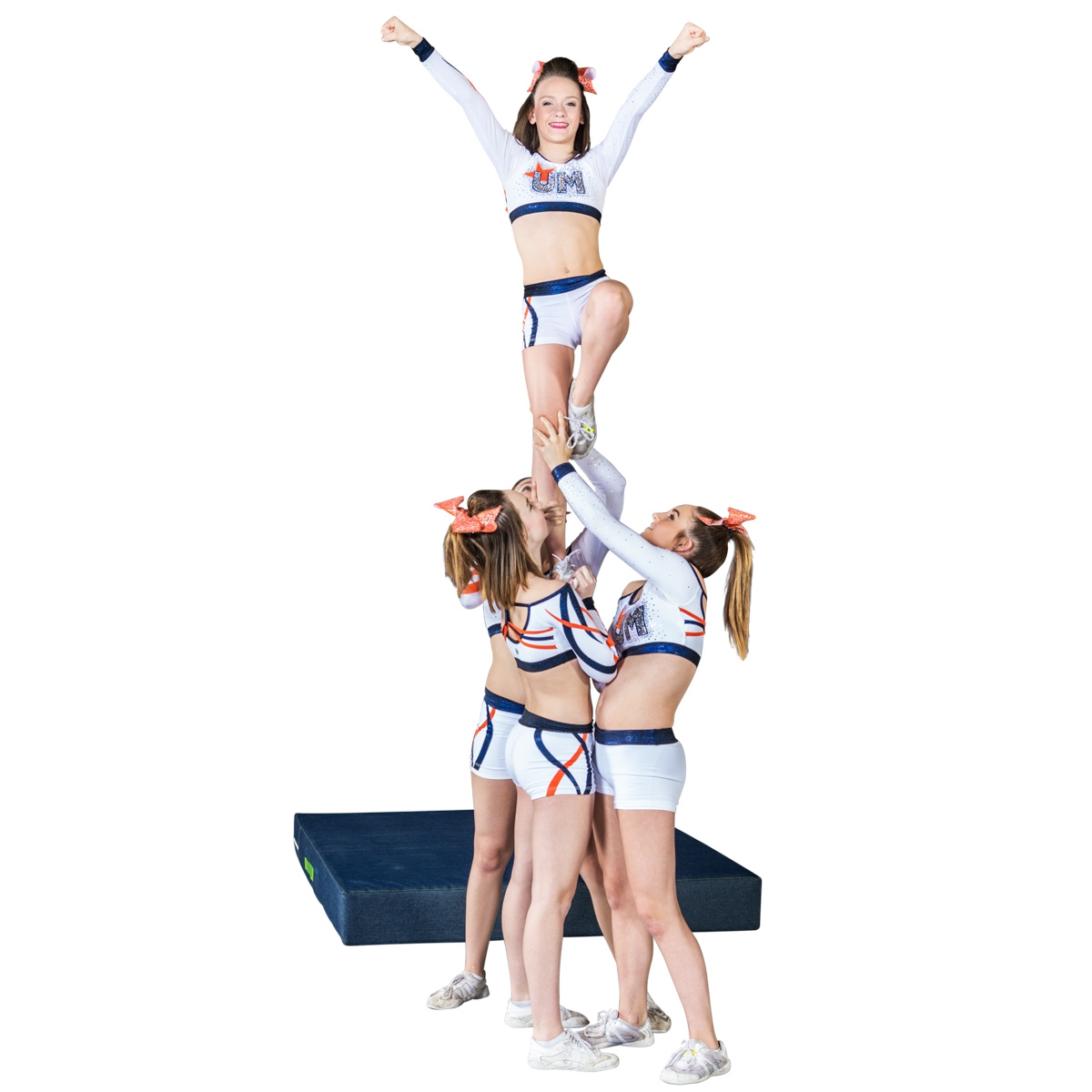 cheerleaders in formation with mat