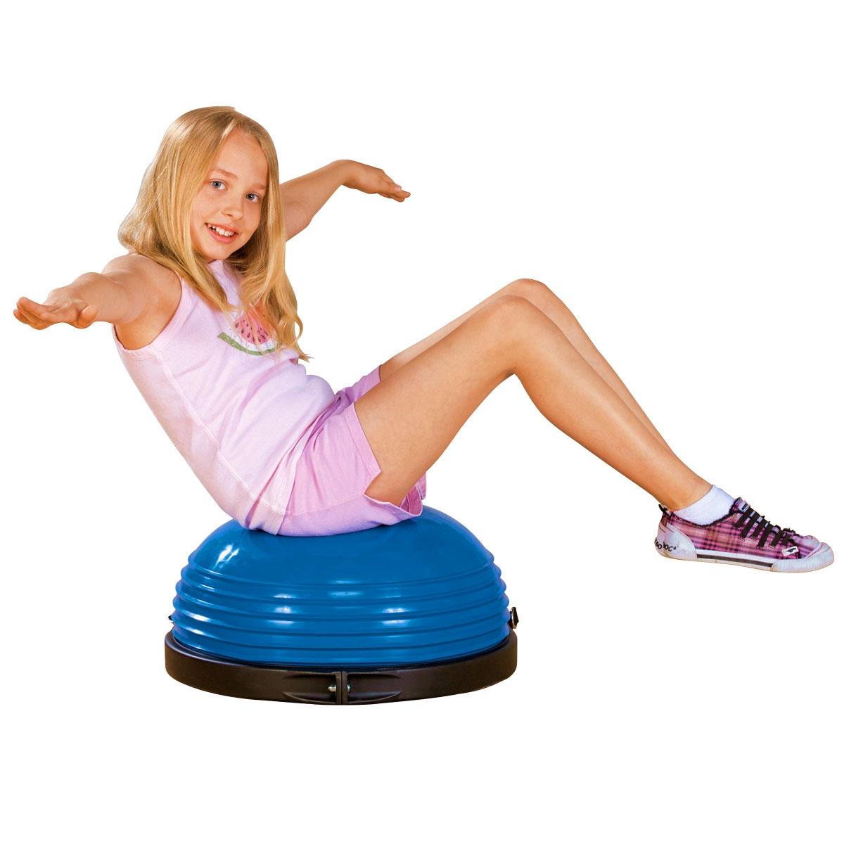 girl sitting on blue exercise balance dome training core