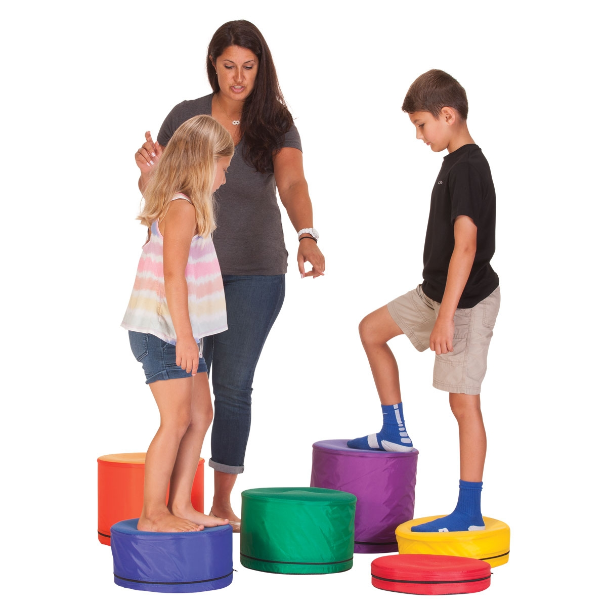 teacher showing a boy and girl how to use graduated foam steps