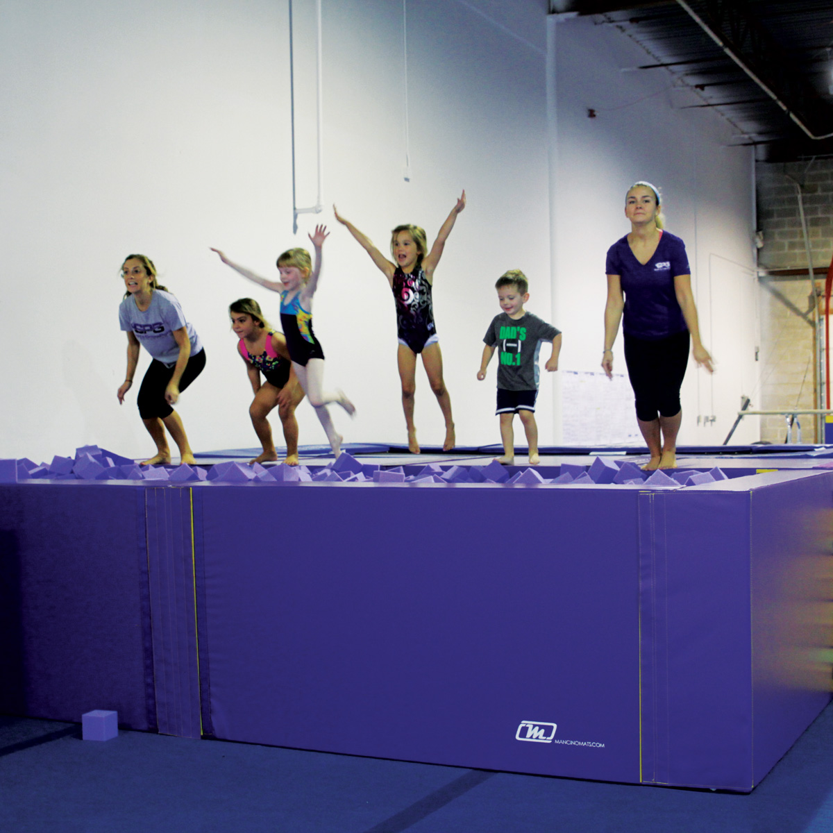 kids jumping in foam play gymnastics pit - mancino mats