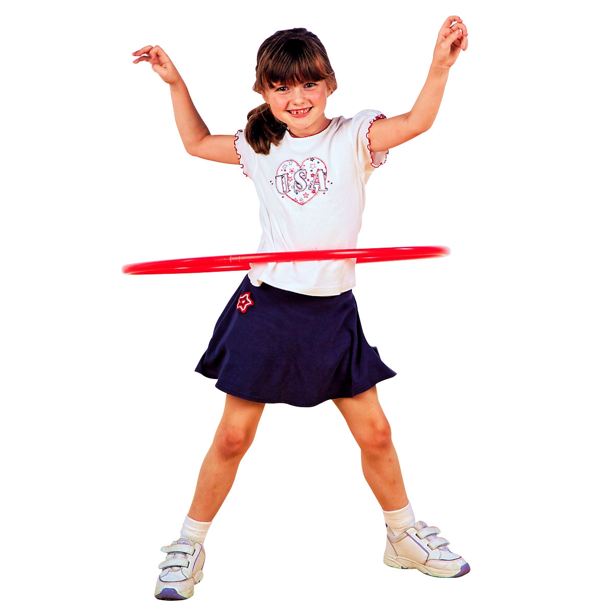 little girl in skirt twirling a red hula hoop