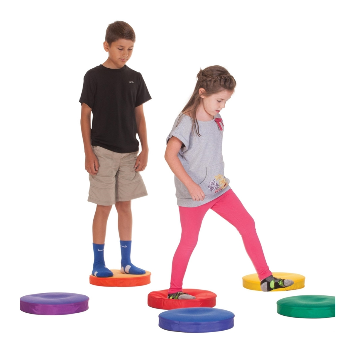 boy and girl taking turns stepping on sound spots