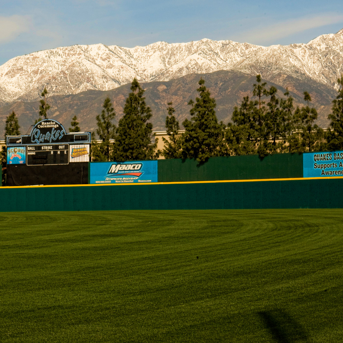 stadium wall padding with mountains in background mancino mats