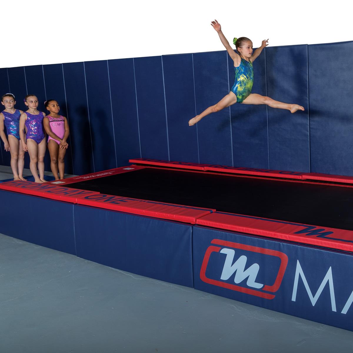 tumbl trak side skirt padded panels with gymnasts top pads and removable wall padding mats - mancino mats