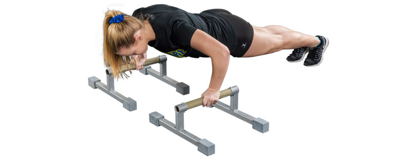gymnast doing push ups with mancino parallettes