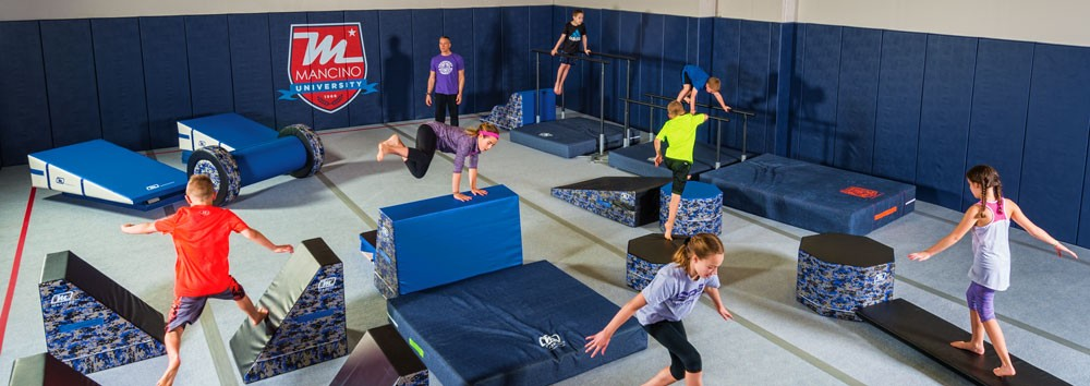 Gymnastics training with flor and wall mat